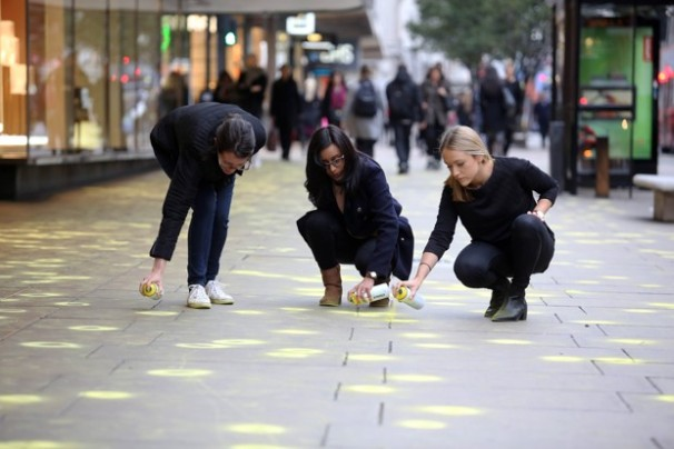 EMBARGOED TO 0700 TUESDAY OCTOBER 20th EDITORIAL USE ONLY (Left to right) Ruth Pipkin, Lina Solanki and Natalie Merrix - representatives from The Chewing Gum Action Group (CGAG), highlight pieces of discarded gum, using fluorescent chalk, on the pavements of London's Oxford Street, to launch their national campaign to reduce gum litter. PRESS ASSOCIATION Photo. Picture date: Monday October 19, 2015. Now in its 10th year, the annual campaign sees representatives from the chewing gum industry, Government and environmental charity Keep Britain Tidy working with councils and Business Improvement Districts (BIDs) across the whole of the UK to develop local initiatives to reduce chewing gum litter. Photo credit should read: Gretel Ensignia/PA Wire