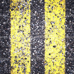 depositphotos_36468231-Asphalt-road-texture-with-yellow-stripe